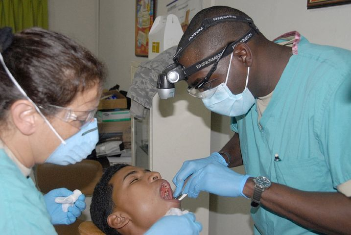 two emergency dentists in Lilydale performing a surgery on a patient